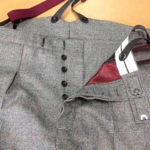 Bespoke trousers with brace tops and button fly.